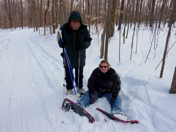 Ken and Vicki Bordwell on a trail. Ken is on the left and Vicki, his daughter, is on the right on her backside from a fall.