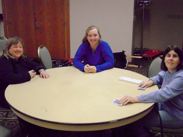 Punderson Manor Scenic Room. Shown from left to right are: Lynn Power, Gracie Hurley, and Katie Frederick waiting for a fourth person so they can start playing Euchre.