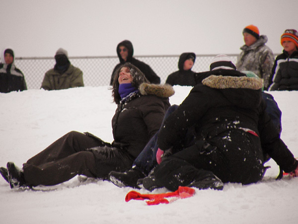 More Sledders. Shown from left to right: Katie Frederick, Catherine Bister, and Rebecca Schumacher. You can only see Katie's face. This was after a wreck on the sledding hill.